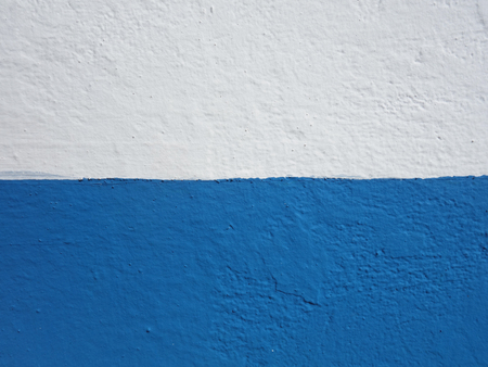 Wall background painted half blue and half white.