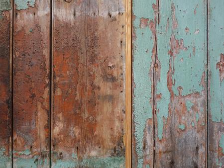 wooden plank background. Worn green paint.