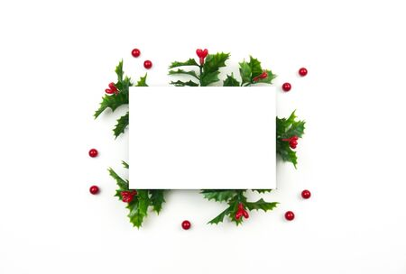 Creative Christmas layout. Mistletoe on white background whit copy space. Flat lay top view.