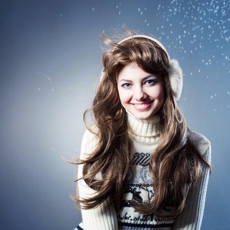 young beautiful girl rejoices to snow Standard-Bild