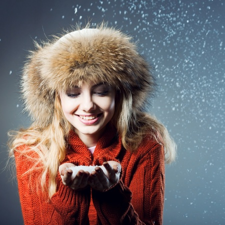 rejoices: young beautiful girl rejoices to snow Stock Photo