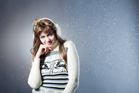 young beautiful girl rejoices to snow photo