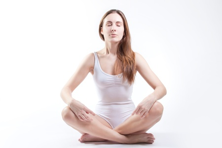 Young woman doing yoga Stock Photo - 8851829