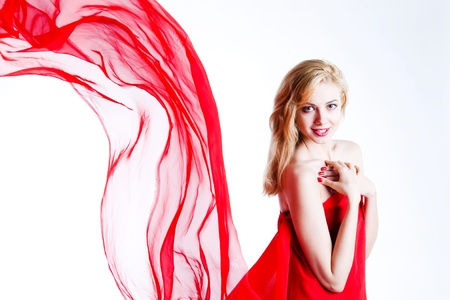 red, beautiful blonde in a red dress photo