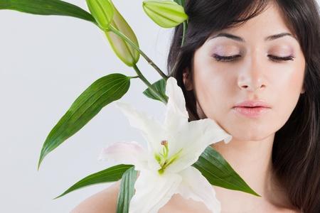 Beautiful woman with lily Stockfoto