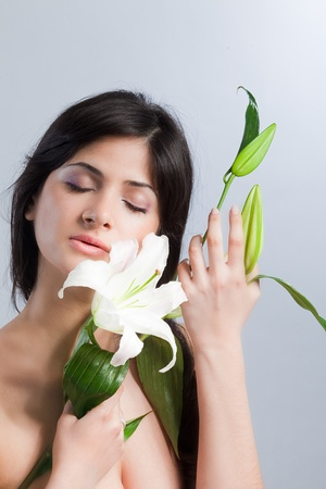 Beautiful woman with lily Stock Photo - 9233849