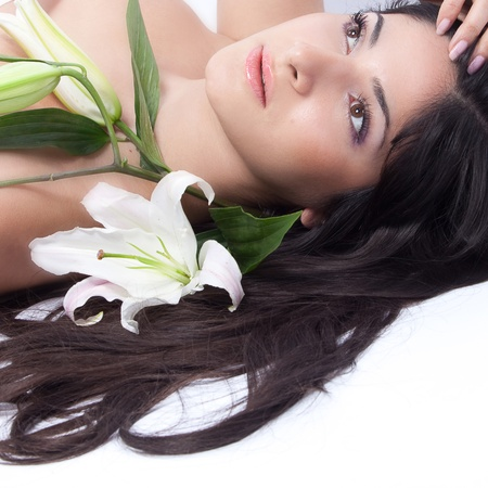 unblemished: Beautiful woman with lily Stock Photo