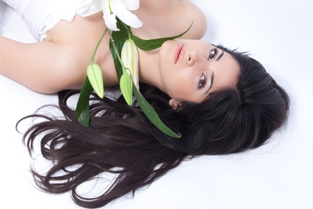 womanliness: Beautiful woman with lily Stock Photo
