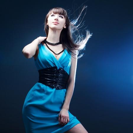 beautiful girl in a blue dress photo