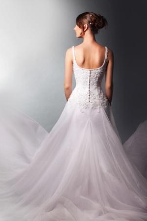 beautiful  bride in a luxurious wedding dress photo