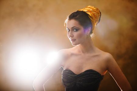 hypnotise: girl on a gold background Stock Photo