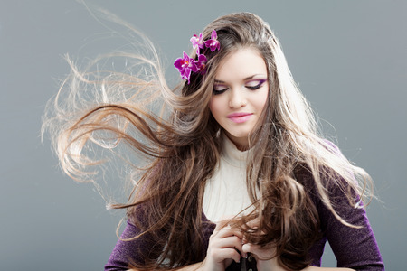 young woman with long hair photo