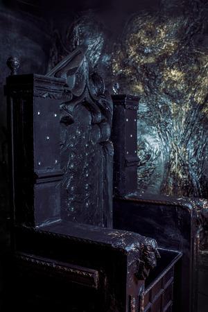 Royal throne. dark Gothic throne, close up Stock Photo