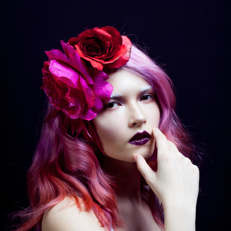 coloring lips: beautiful girl with pink hair,  the hand of a face