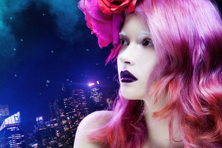 beautiful girl with pink hair,  profile against the lights of  night city