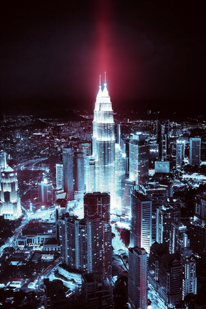 Kuala Lumpur skyline at night, tinting, shades of blue