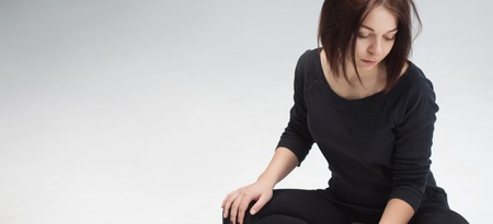 lotus position: young beautiful woman sitting in lotus position Stock Photo
