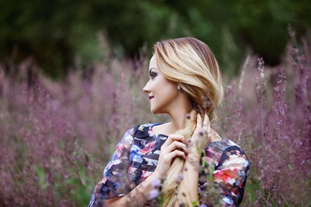 The young beautiful girl on a meadow