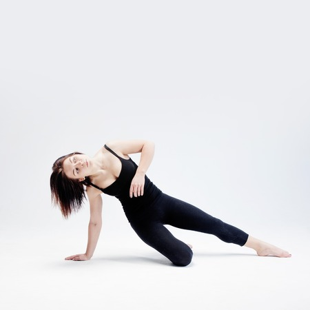 The athletic girl on white background, figure Stock Photo