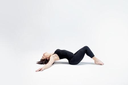 deflection: The athletic girl on white background, figure Stock Photo