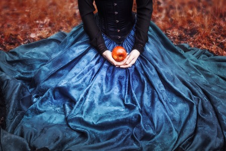 tales: Snow White princess with the famous red apple. Stock Photo