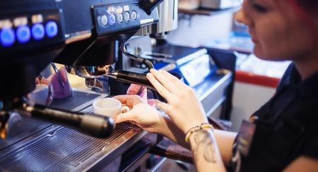 espresso machine: Espresso machine making coffee in pub, bar Stock Photo