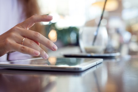 girl works on the digital tablet, a small depth of field