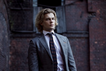 business style: young businessman in a gray suit, business style, Stock Photo