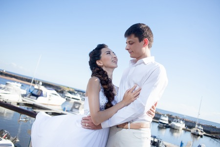 yacht club: bride and groom on the background of the yacht club