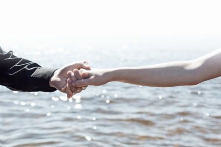 parting the sea: The boy and girl are holding hands