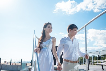 bride and groom on the background of the yacht club