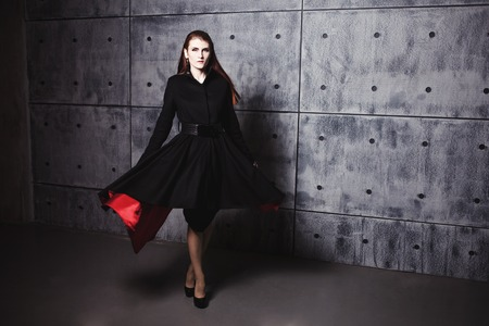 winter fashion: Elegant young woman posing in the coat