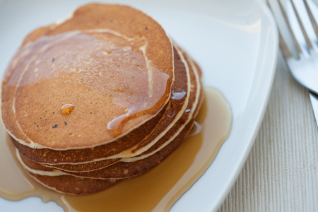 Stack of pancakes with the maple syrup