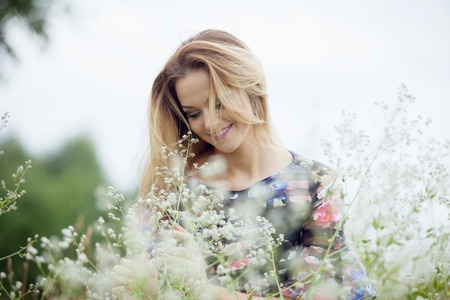 beautiful girl: The young beautiful girl on a meadow