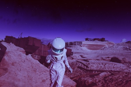 continuum: futuristic astronaut on another planet, sandy red planet Stock Photo