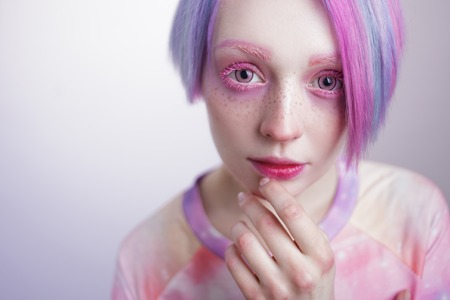 a young girl with pink eyes and hair, like a doll