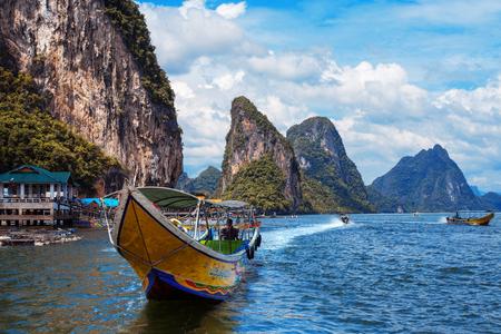 railay: long boat and rocks on railay beach, Thailand