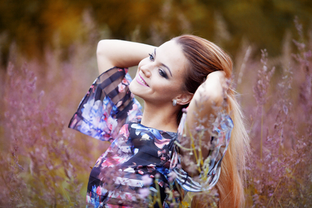 feeling happy: The young beautiful girl on a meadow