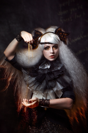 conjuring: girl in the image of a witch with a lush white hair