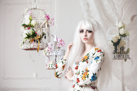 platinum hair: Beautiful girl with white hair in the background of cells with flowers, puppet style Stock Photo