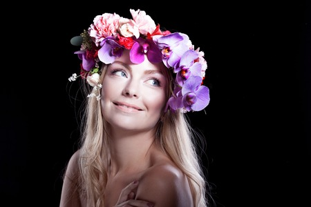 black professional: portrait of young beautiful woman in wreath of flowers