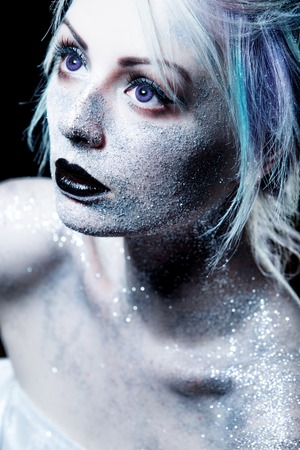blue face: Bright fashion makeup, creative body art on the theme of space and stars.
