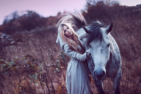 the young animal: Portrait of a beauty blondie with horse