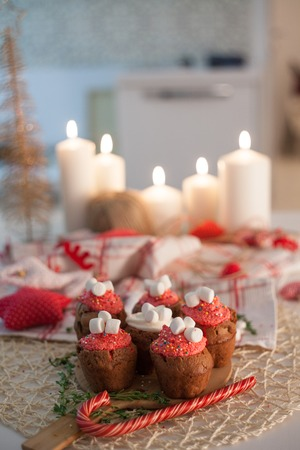 defocussed: New Year celebration cupcakes, chocolate muffins on the table