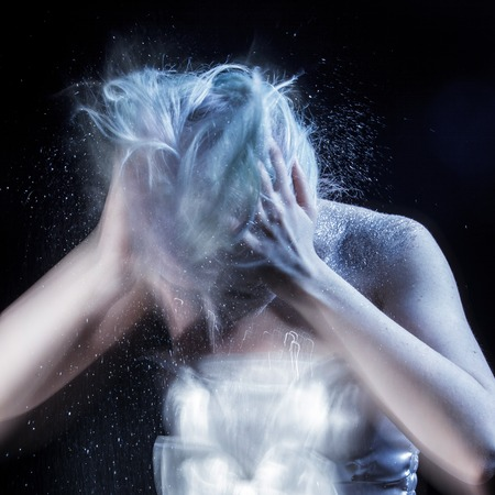 freaked: girl shakes a lot of dandruff from the head, the grotesque and the exaggerated, extremely exaggerated problem Stock Photo