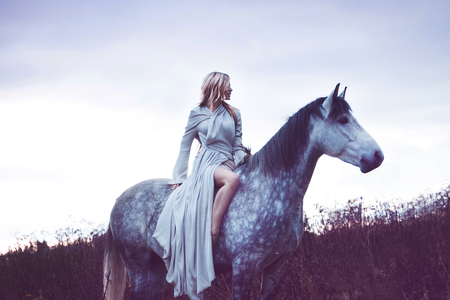 horse blonde: Portrait of a beauty blondie with horse