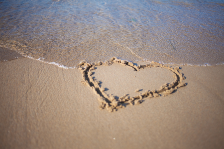 confession: confession of love, on the beach, summer, sea and sun Stock Photo