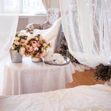 romance rose: Bouquets of flowers in bedroom, interior decor, romantic setting Stock Photo