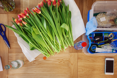 getting started: workplace of the florist, still life with bouquet of tulips