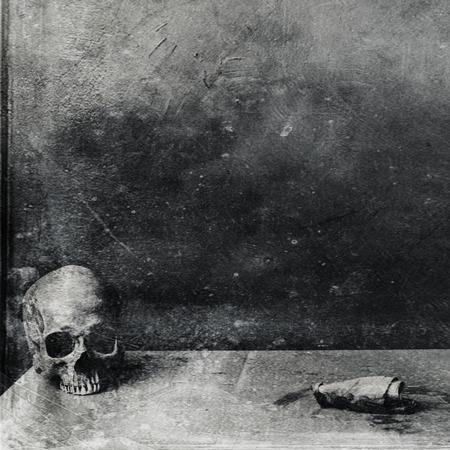 Very scary skull on the table. Textured grunge black and white background